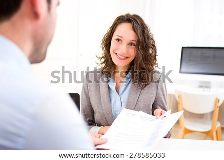 View of a Young attractive woman during job interview - stock photo