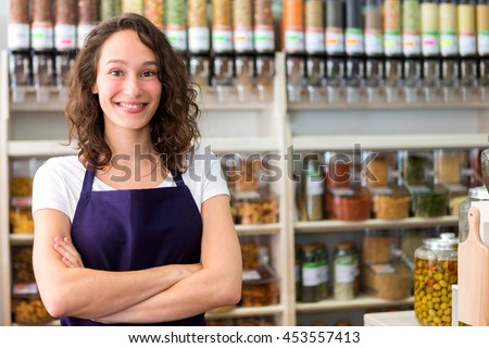 View of a Young attractive woman working at the grocery store - stock photo