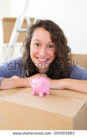 View of a Young couple saving money in a piggy bank - stock photo
