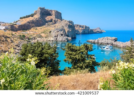 View of Acropolis and St Pauls harbor in Lindos. Rhodes, Greece  - stock photo