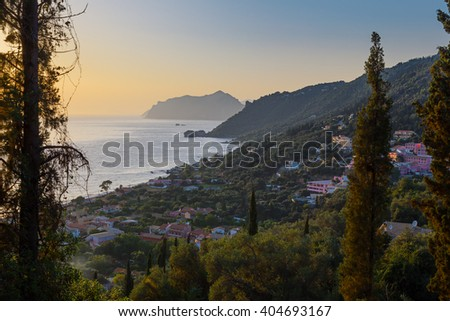 View of Agios Gordios village on Corfu coast at sunset, Greece - stock photo