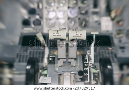 View of aircraft thrust lever. Motion effect. - stock photo