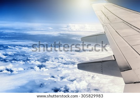 View of airplane wing through the window. Travel concept  - stock photo