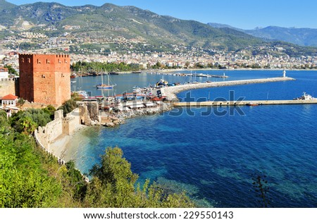View of Alanya harbor form Alanya peninsula. Turkish Riviera - stock photo