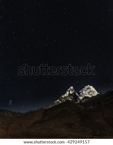 View of Ama Dablam in the Moonlight - Nepal, Himalayas - stock photo