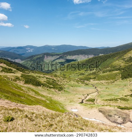 View of amazing valley with creek in the spring ukrainian mountains - Svydovets range, Carpathians, West Ukraine - stock photo