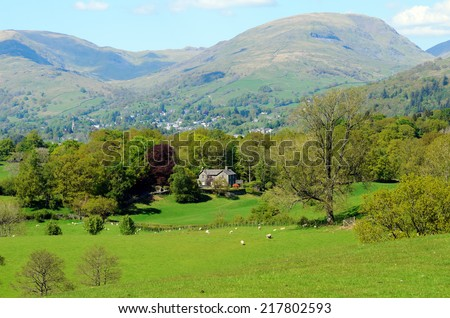 View of Ambleside and Hart Crag from High Wray near Lake Windermere in the Lake District National Park - stock photo