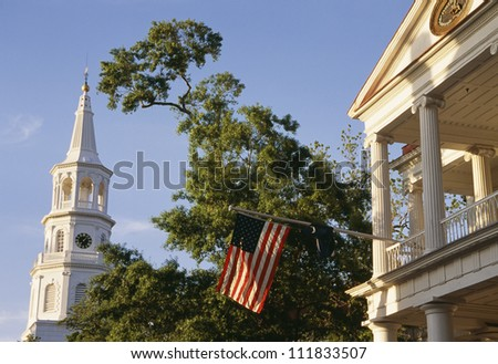 View of American flag with church - stock photo