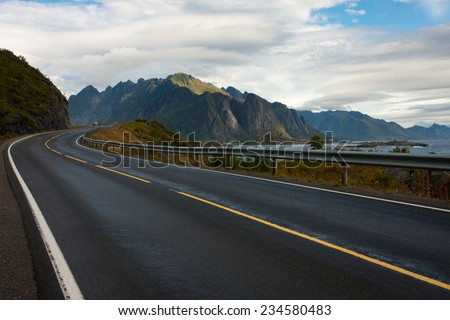 view of an empty winding road at the Lofoten islands  - stock photo