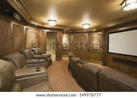 View of an entertainment room with leather seats and lit lights - stock photo