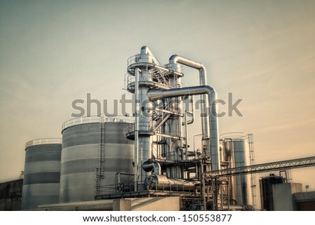View of an industrial oil refinery with shiny tubes. - stock photo