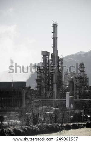 View of an Oil Refinery Plant. Vertical shot - stock photo