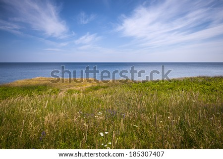 View of Atlantic ocean from cliff edge in Prince Edward Island, Canada. - stock photo