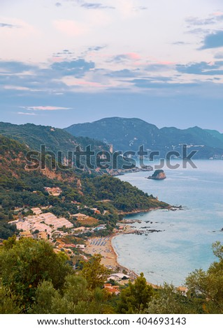 View of Avramis, Pelekas beach at sunset, Corfu, Greece  - stock photo