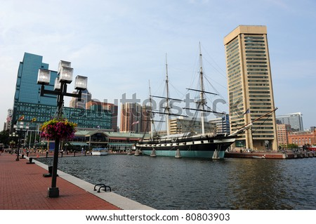 View of Baltimore Harbor with USS Constellation Ship and office buildings - stock photo