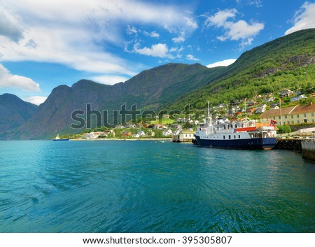 View of bay with tour ship. Aurlandsfjord, Aurland, Norway  - stock photo