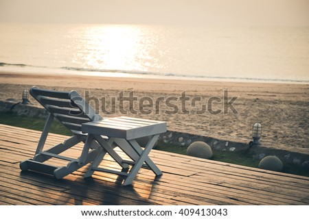 View of beach chair with beautiful sunset for vacations in Cha Am, Phetchaburi, Thailand. - stock photo