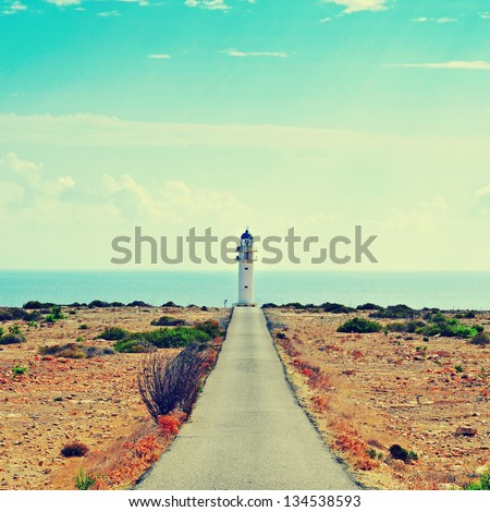 View of beacon Far de Barbaria in Formentera, Balearic Islands, Spain, with a retro effect - stock photo
