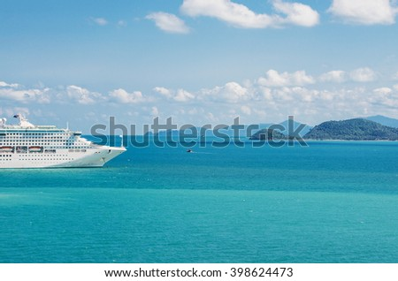 view of beautiful  coastline with anchored cruise ship - stock photo