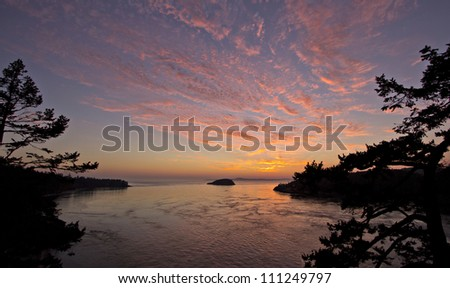 View of beautiful sunset from Deception Pass - stock photo