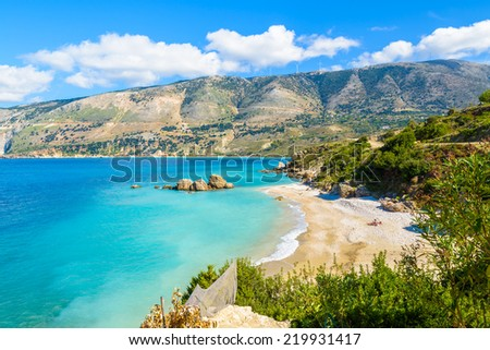 View of beautiful Voula beach and bay with mountains near Zola village, Kefalonia island, Greece - stock photo