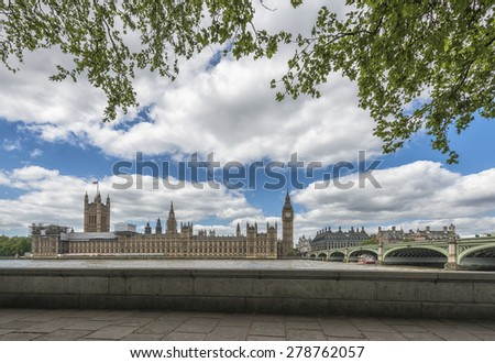 View of Big Ben and Houses of Parliament in London across Thames - stock photo