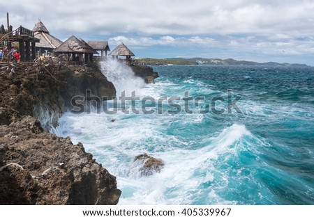 View of big waves at  Crystal Cove small island near Boracay island in the Philippines  - stock photo