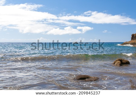 View of black sand volcanic Antequera Beach and big rocks in Tenerife, Canary Islands, Spain - stock photo