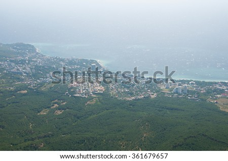 View of Black Sea coast with its resort villages from the top of Ai-Petri mountain, Crimea - stock photo
