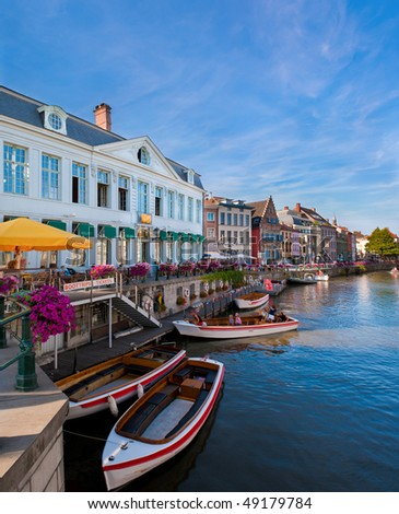 View of boats on canal in sunny day - stock photo