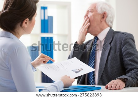 View of bored boss during job interview - stock photo
