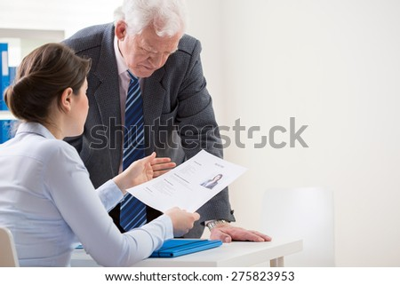 View of boss talking with job candidate - stock photo