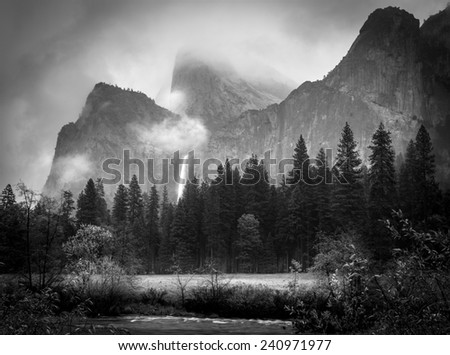 View of Bridalveil Falls on a foggy morning after a clearing storm - stock photo