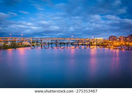 View of bridges over the Williamette River at twilight, in Portland, Oregon. - stock photo