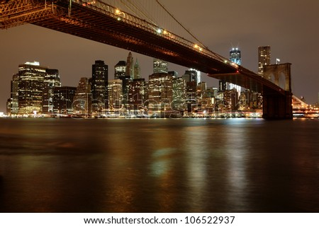 View of Brooklyn Bridge and Downtown Manhattan across the east river - stock photo