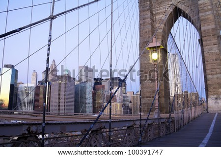 View of Brooklyn Bridge, Lower Manhattan in the background , in a sunny, early morning, New York, United States - stock photo