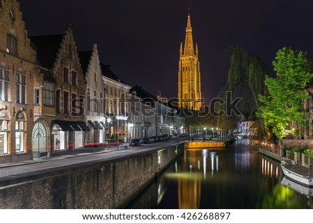 view of Bruges with Church of Our Lady at evening, Belgium - stock photo