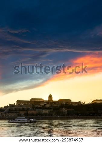 View of buda castle in Budapest from danube riverat sunset, Hungary - stock photo