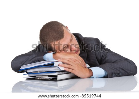 View of businessman sleep resting on stack of paperwork - stock photo