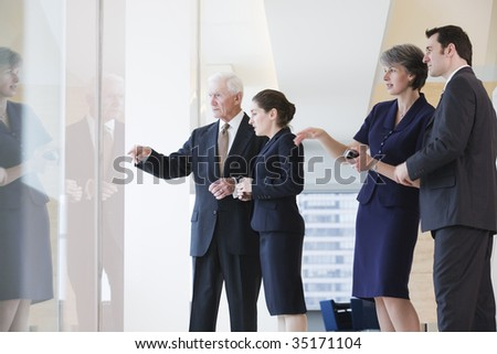 View of businesspeople discussing in an office. - stock photo