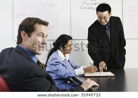 View of businesspeople in an office. - stock photo