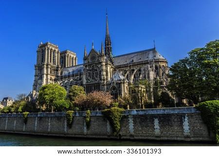 View of Cathedral Notre Dame de Paris - a most famous Gothic, Roman Catholic cathedral (1163 - 1345) on the eastern half of the Cite Island. Sunset. - stock photo
