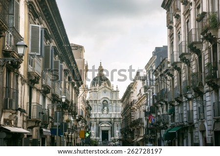 View of Cathedral of St. Agatha and Via Garibaldi street. Catania, Sicily, Italy - stock photo