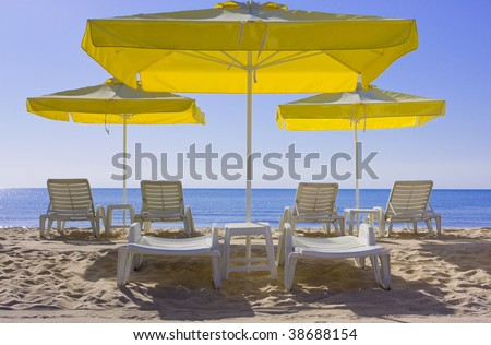 view of chairs and umbrellas on the beach - stock photo
