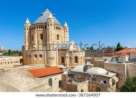 View of Church of Dormition under blue sky in Jerusalem, Israel. - stock photo