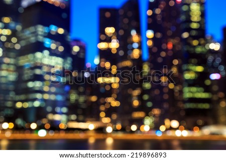 View of city night lights blurred bokeh background. - stock photo