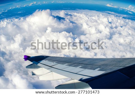 View of clouds from a airplane window - stock photo