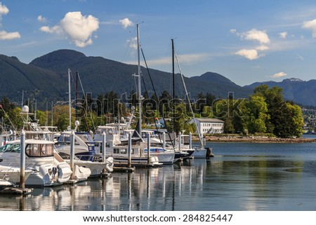 View of Coal Harbor marina and Stanley Park in Downtown Vancouver, Canada. - stock photo