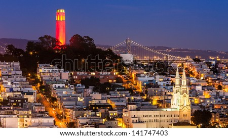 View of Coit Tower and St. Peter and Paul church at night, from Lombard street. - stock photo