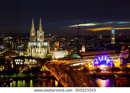 View of Cologne and the Cologne cathedral in the night from height of bird's flight - stock photo